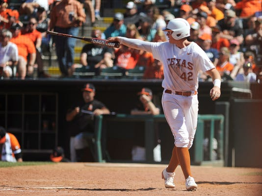 In this May 28, 2017, photo, Texas' Kacy Clemens celebrates after scoring a run in the championship game in the Big 12 baseball tournament in Oklahoma City. Thirty-four years after Texas and pitcher Roger Clemens won the College World Series, two younger Clemenses are chasing another title with the Longhorns. (AP Photo/Kyle Phillips)