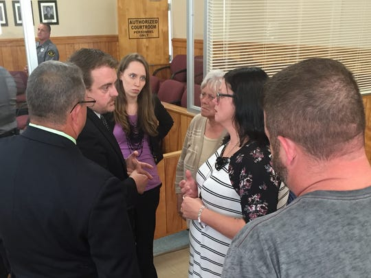 District Attorney Ray Crouch, Assistant District Attorney Dani Bryson and Stewart County Sheriff's Investigator David Evans, left, talk with Nicole Brabant and her family members about what happens next after Zachary Ponder was sentenced to life in prison after being found guilty of first-degree murder in the death of Seth Brabant.