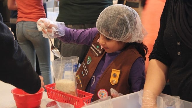 Religious and non-religious community organizations participated in April's Mega-Food Packing event.