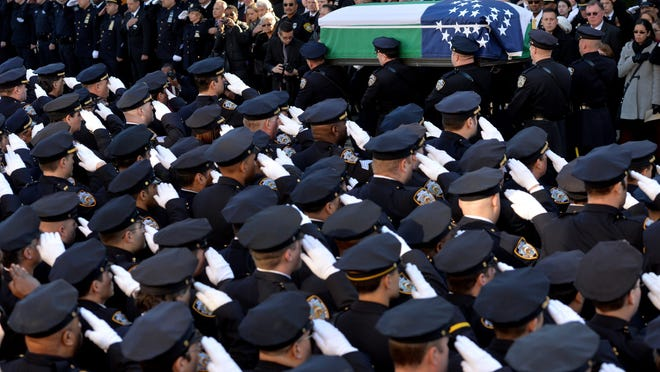 Police officers carry the coffin of New York City police Officer Rafael Ramos after his funeral Saturday at Christ Tabernacle Church in New York.