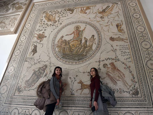 Tourists pose for a photo at the national Bardo Museum