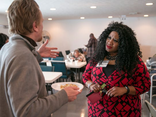 Diahann Johnson (right), chats with Tim Brown at Temple
