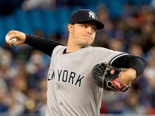 New York Yankees starting pitcher Sonny Gray throws