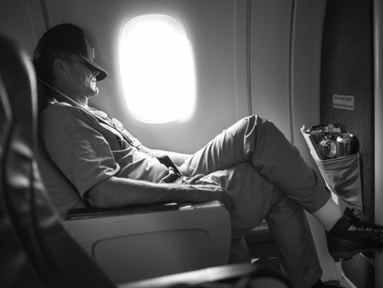 Jim Harbaugh catches some shut-eye on a plane during