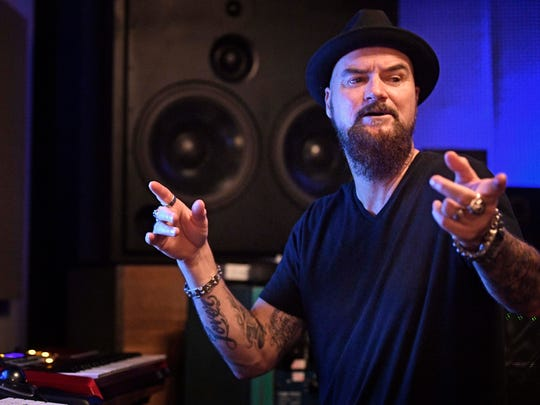 Hip hop producer and songwriter Jim Jonsin works in his new studio, in Brentwood, Tenn., Wednesday Nov. 15, 2017. Jonsin has relocated his business to Nashville, providing a spark to the city's hip-hop scene that he says has unlimited potential.