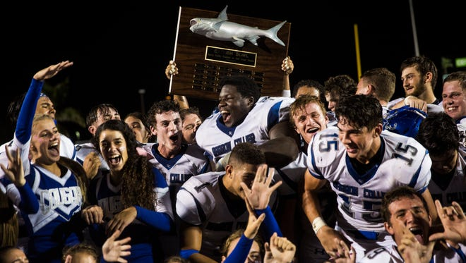 Barron Collier football players celebrate their 45-12 victory over Gulf Coast during the Catfish Bowl at Gulf Coast High School in North Naples on Friday, Oct. 06, 2017.