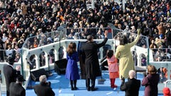 The Obama family waves to the crowd during his Jan.