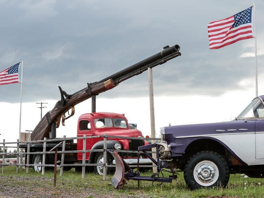 """Big Ernie,"" the world's largest working rifle as noted by ""The Guinness Book of World Records,"" is on display in the front yard of Da Yoopers Tourist Trap in Ishpeming, in Michigan's Upper Peninsula."
