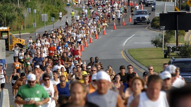 Runners make their way to the Bob Sikes Bridge at the Capt'n Fun Runners's annual Capt'n Fun Bushwacker 5K Run to benefit Big Brothers Big Sisters of Northwest Florida. The 5K returns Saturday.