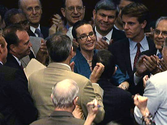 Giffords appears on the floor of the House on Aug. 1, 2011, for the first time since the shooting to vote on the debt-ceiling compromise.