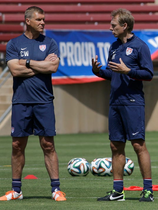 United States soccer coach Jürgen Klinsmann, right, speaks with goalie coach Chris Woods during training in preparation for the World Cup soccer tournament on Thursday, May 22, 2014, in Stanford, Calif. (AP Photo/Ben Margot)
