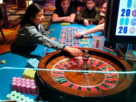This Jan. 31, 2018, photo shows a dealer conducting a game of roulette at the Tropicana Casino and Resort in Atlantic City N.J. Atlantic City's seven casinos saw their gross operating profits increase by 22.5 percent last year, to $723 million. (AP Photo/Wayne Parry)