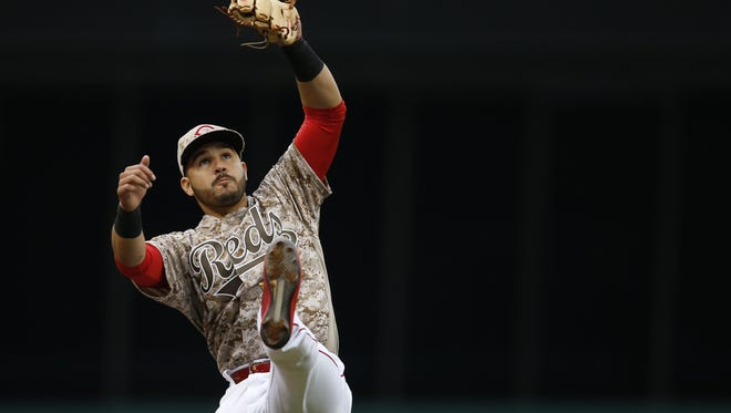 Cincinnati Reds third baseman Eugenio Suarez (7) leaps but is unable to field a line drive in the fifth inning during the MLB game between Seattle Mariners and the Cincinnati Reds, Saturday, May 21, 2016, at Great American Ball Park in Cincinnati.