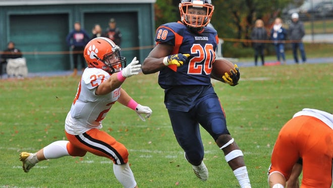Thayer Academy's Luca Milano of Hingham tries to tackle Milton Academy's Kalel Mullings of West Roxbury as he runs for a touchdown during football action at Milton Academy on Saturday, Oct. 12, 2019. Tom Gorman/For The Patriot Ledger