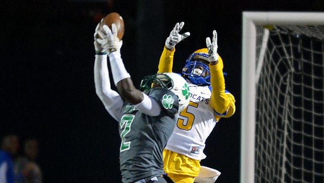 Collins' Timothy Durr (2) intercepts the ball in the end zone Friday night against Kemper County.