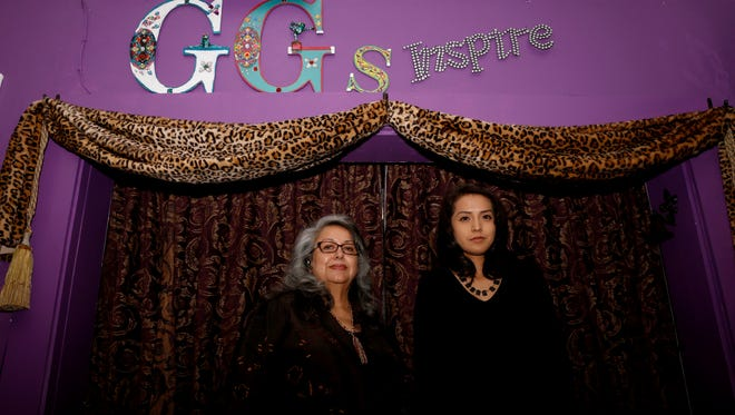 Owner Maria T. Garcia, left, and Sarah Blueeyes pose for a photo on Nov. 2 at GG's Designs, Alterations & More Boutique in Farmington, where Blueeyes' designs will be featured in a fashion show this weekend.