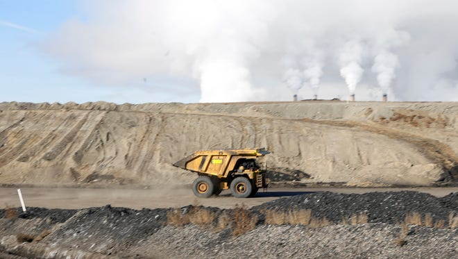 A dump truck moves down a service road on Jan. 13 at the San Juan Mine in Waterflow