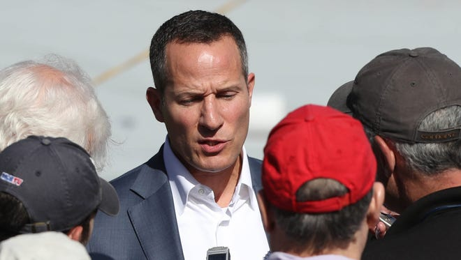 Chris Ilitch talks to reporters Friday, Feb. 24, 2017, at Publix Field at Joker Marchant Stadium in Lakeland, Fla.