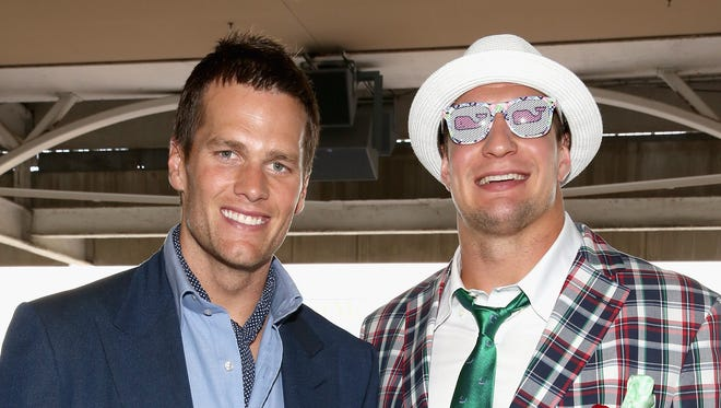 In a file photo from 2015,  Tom Brady  and Rob Gronkowski attend the 141st Kentucky Derby at Churchill Downs.