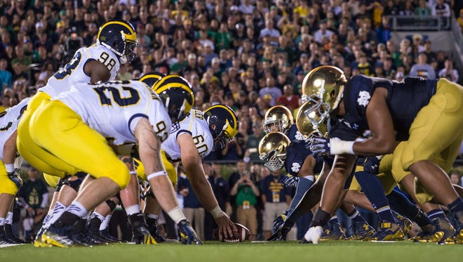 Sep 6, 2014; South Bend, IN, USA; The Michigan Wolverines and the Notre Dame Fighting Irish face off at the line of scrimmage in the third quarter at Notre Dame Stadium.