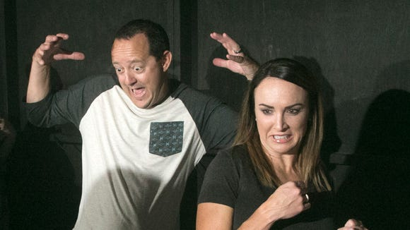 People react to frights, scares and startles at the 13th Floor Haunted House in Phoenix on Friday, October 14, 2016.