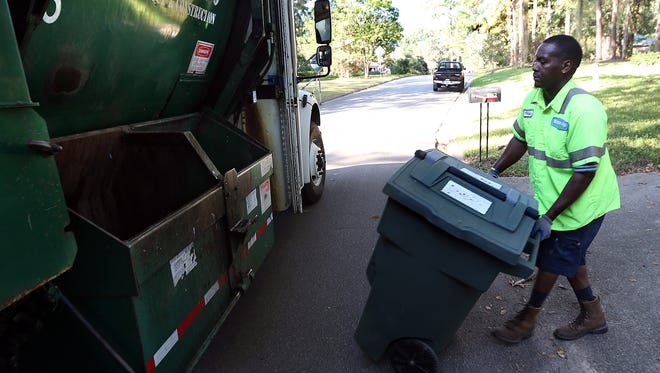 Terrance Williams of Waste Pro collects curb side recycling in Tallahassee.