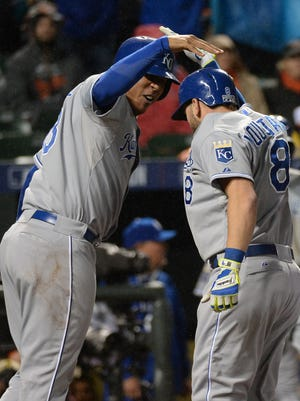 Mike Moustakas and Salvador Perez celebrate Moustakas' two-run homer that sealed the Royals' 10-inning Game 1 win.