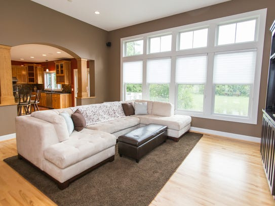 Huge windows let the light into the living room at