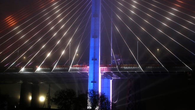 """LED lights illuminate the new Kosciuszko Bridge span connecting Brooklyn and Queens during a performance of the """"New York Harbor of Lights"""" at the bridge's grand opening ceremony, Thursday, April 27, 2017, in New York."""