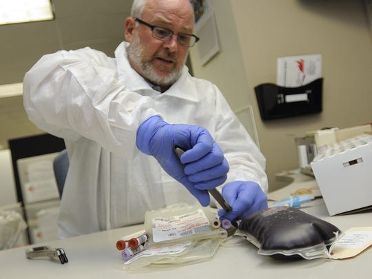 ARed Cross employee prepares donated blood for shipment at the American Red Cross in Lansing in this 2012 photo.