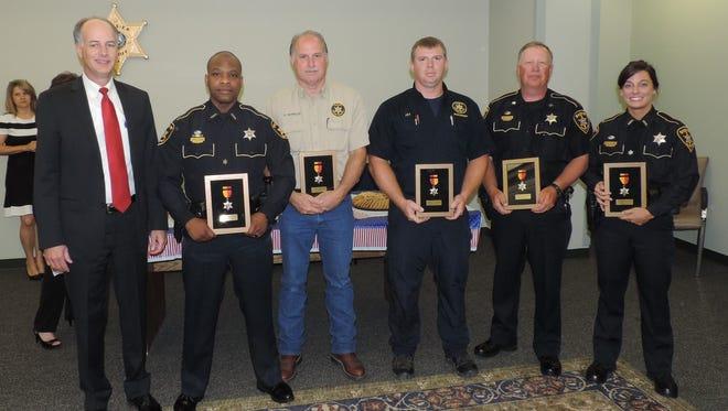 From left to right: Bossier Sheriff Julian Whittington, Deputy Darryl Ware Jr., Lt. David Reynolds, Deputy J