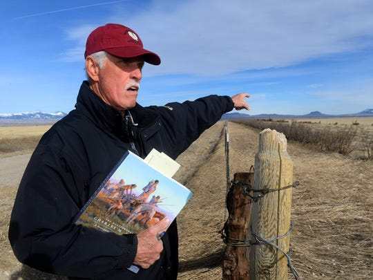 Jim Combs points to Round Butte and Square Butte in Chouteau County that often appear in the backgrounds of C.M. Russell paintings.