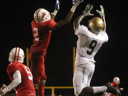 Leon's Jeffrey Perry and Lincoln's Kamari Morales battle for a ball in the air.