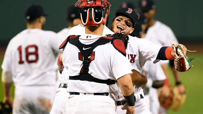 Red Sox right fielder Alex Verdugo celebrates with catcher Christian Vazquez after defeating the Blue Jays, 5-3, at Fenway Park on Friday night. Verdugo hit two home runs in the game and made a spectacular catch to prevent a Toronto homer.