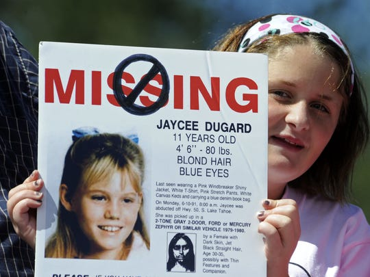 Kaitlyn Mills, 11, of West Sacramento holds an altered missing child poster at the rally after the Pink Ribbon Parade to honor Jaycee Lee Dugard in South Lake Tahoe on Sunday, Sept. 6, 2009.