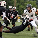 Willard's Brock Howard gains some yardage against Central High on Friday night.