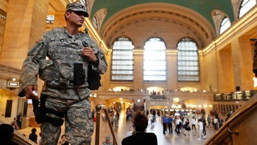 Members of the U.S. Armed Forces stand guard in Grand Central Terminal on Sept. 18, 2016, in New York. Gov. Andrew Cuomo  said about 1,000 additional law enforcement officers were being deployed after a blast in Chelsea, a neighborhood on Manhattan's west side.