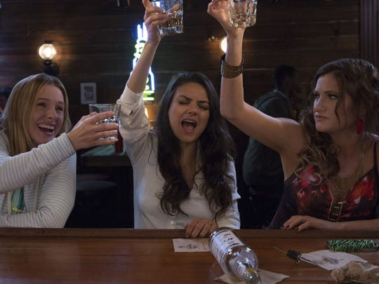 """Bad Moms,"" played by (from left) Kristen Bell, Mila Kunis and Kathryn Hahn, decide to get their drink on."