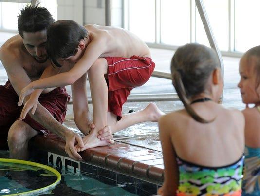 636031055934011570-swim-lessons.jpg