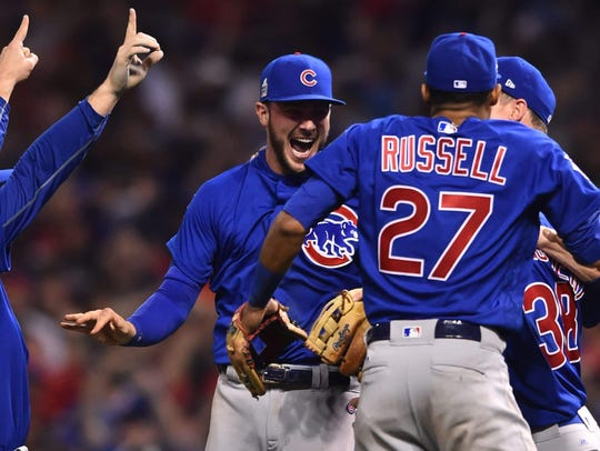 The Chicago Cubs defeated the Cleveland Indians 8-7