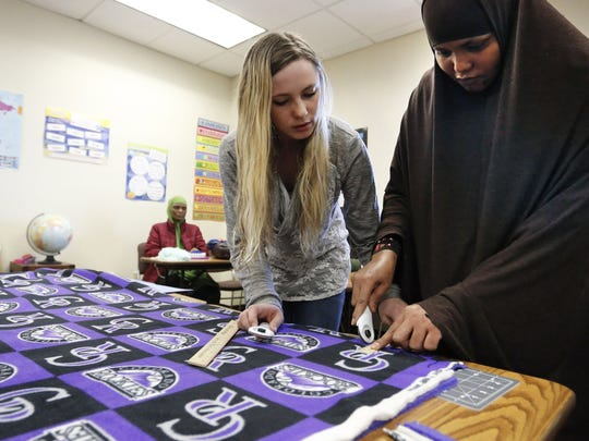 Somali refugee and student Khadija Ahmed, right, works with teacher Chaundra Jacobs in the Skills Development class at the Career Pathways program at Morgan Community College, in Fort Morgan.