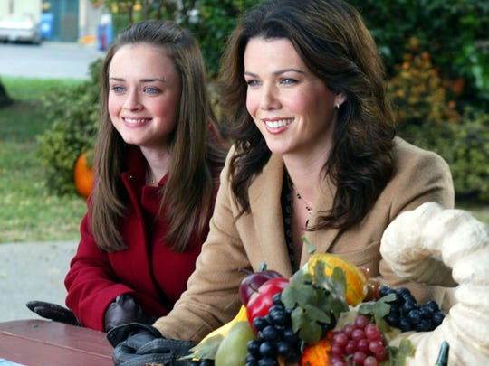 """Rory (Alexis Bledel) and Lorelei (Lauren Graham) attend four Thanksgivings on """"The Gilmore Girls."""""""