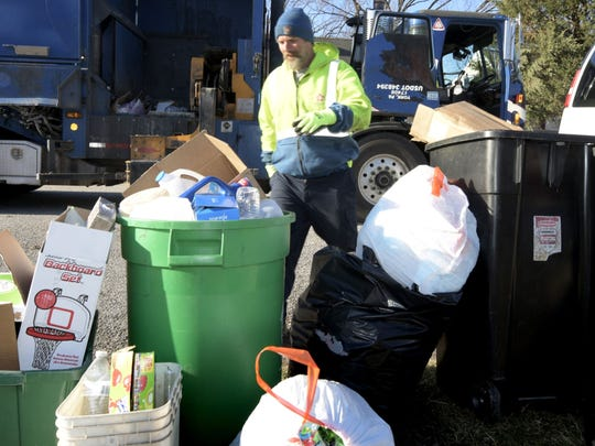 Republic Services loader Dennis Habecker collecting post-Christmas recyclables in the Fireside neighborhood in York City Tuesday, Dec. 26, 2017. Bill Kalina photo