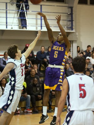St. Martinville's Drapper Anthony made three clutch 3-pointers for the Tigers late, but the visitors still fell a point short 67-66 to Teurlings Catholic on Tuesday in District 5-4A play.