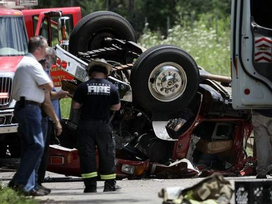 An overturned truck rests after it flipped on Halls Hill Pike while responding to a fire on that road. At least one firefighter was trapped in the vehicle.