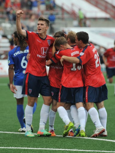 Indiana players celebrate a goal by Blake Smith in the first half as the Indy Eleven hosted the Dayton  Dutch Lions in U.S. Open Cup competition at Michael A. Carroll Stadium at IUPUI Wednesday May 28, 2014.