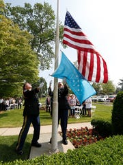 Frank Morgenthaler, left, and Peter Flumefreddo from American Legion Post 112 replace the American Flag and the Medal of Honor Flag during the Medal of Honor Wreath Ceremony at Kensico Cemetery in Valhalla on Friday, May 27, 2016.