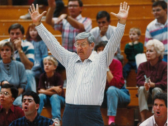 McMurry University basketball coach Hershel Kimbrell reacts - the fans' faces suggest - to a bad call or no call during an Indians game in 1989. He retired the next season after 31 years at McMurry.