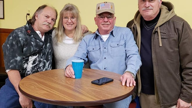 Mike Muntz, third from left, with Sheriff Carl DuBois, far right, and my husband, Jay and I at Mike's benefit last year.