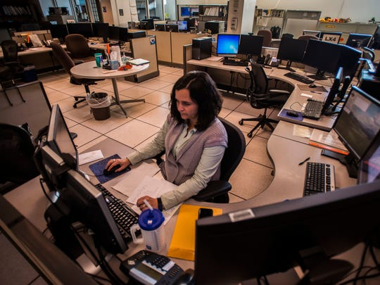 National Weather Service Meteorologist Jessica Neiles monitors weather conditions at the Burlington International Airport office, which has been understaffed since 2012, according co-worker Brooke Taber.